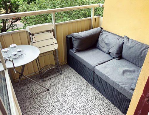 Soffa på balkongen